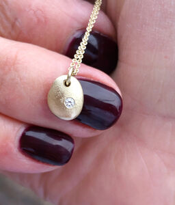 Tiny Solid Gold Pebble Necklace With Feature Diamond