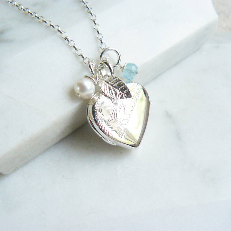 silver locket necklace with charms by lime tree