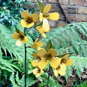 Pair Of Yellow Flower Sculptures