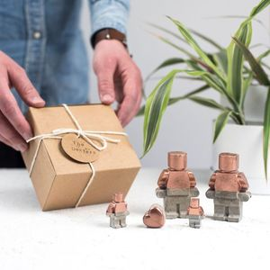 A Copper Concrete Robot Family Set - decorative accessories
