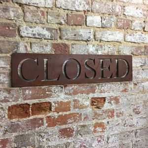 Classic Closed Rusted Metal Sign
