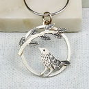silver bird pendant with leaf