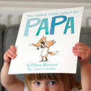 Child holding up personalised children's book