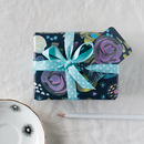 this picture shows you what the gift tag for the Midnight Floral wrap looks like