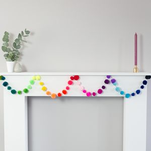 Multicoloured Pom Pom Garlands And String Lights