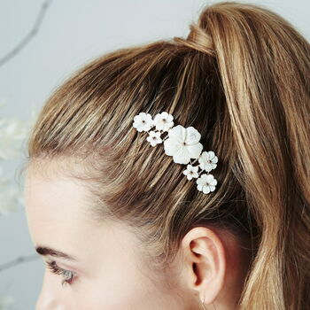 Rose Gold Beth mother of pearl flower comb by Debbie Carlisle worn with sleek high ponytail