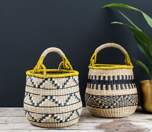 A Stunning Mustard And Black Seagrass Baskets - bedroom