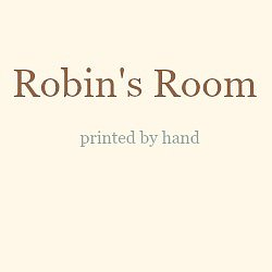 Robin's Room logo in dark brown text followed by the words printed by hand in pale grey text