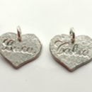 2 sterling silver heart pendants with engraved names
