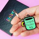 Contains Positivi Tea Enamel Keyring
