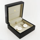 silver cufflinks in black and cream presentation case