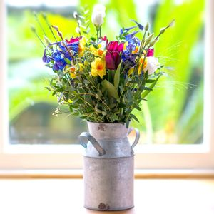 Bundle Of Wild Spring Fresh Flowers With Vintage Churn - fresh & alternative flowers