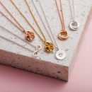 Selection of pendants including; silver infinity symbol, 9ct rose gold and yellow gold plate flower, silver heart disc, 9ct rose gold plate & silver russian ring