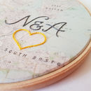 Vintage map in hoop with embroidered heart and initials in cursive font