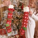 Set Of Two Red Knitted Christmas Jumper Stockings