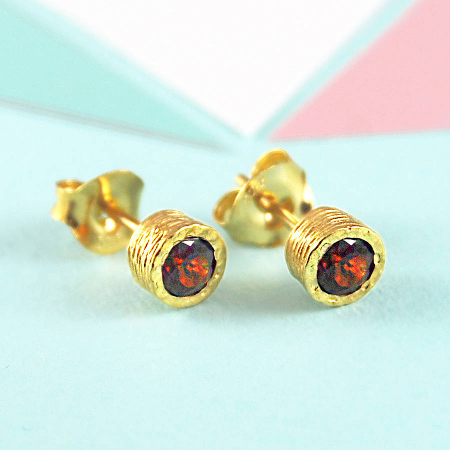 gold and red garnet january birthstone stud earrings by embers