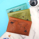 Tan brown, grass green and emerald blue passport covers