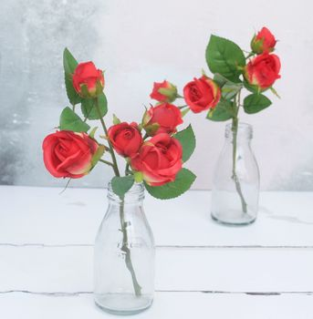 Faux Red Roses In Vase