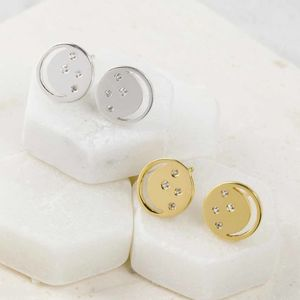 Gold Eclipse Studs With White Topaz - earrings