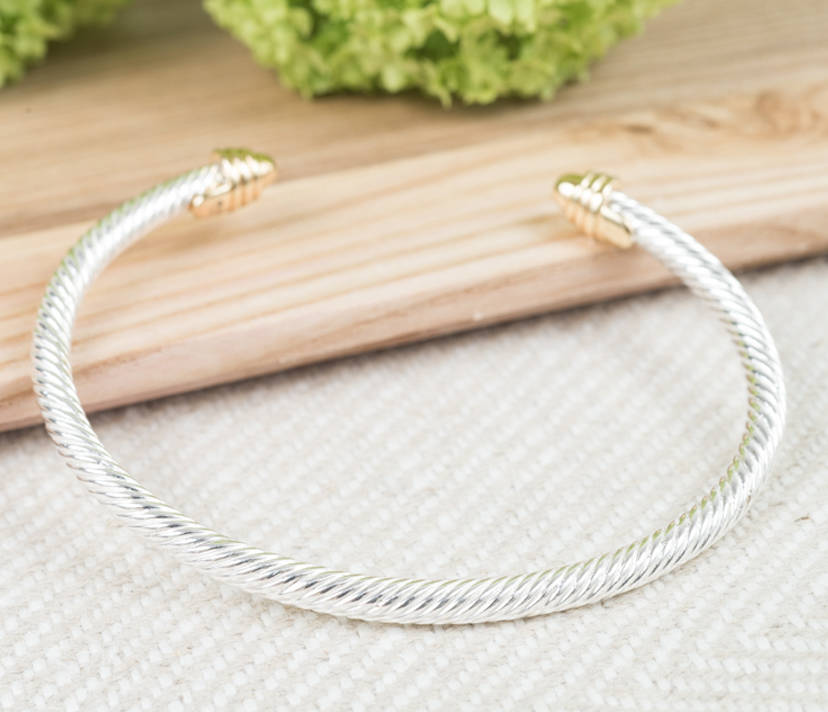 Twisted Silver And Gold Torq Bangle