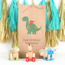 Three Wooden Flexi Dinosaurs And Personalised Gift Bag