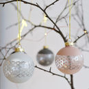 Four Muted Pastel Glass Baubles With Silver Pattern