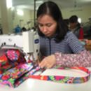 Making the tote bags in Vietnam with fairtrade producer group