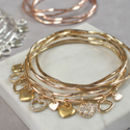 gold diamante heart bangle set