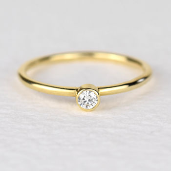 Simple solid gold diamond ring