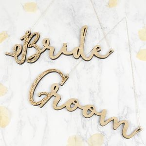 Pair Of Wooden 'Bride' And 'Groom' Hanging Signs - room decorations