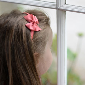 Coral Pinwheel Bow Girls Hairband - children's accessories