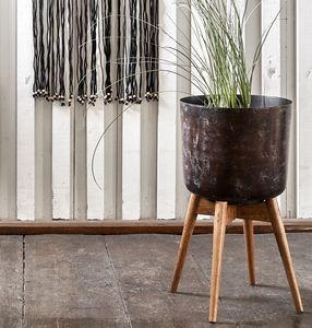 Burnished Brown Plant Pot On A Wooden Stand