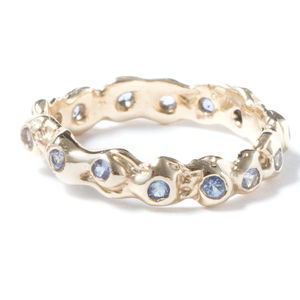 Gold Eternity Ring With Light Blue Sapphires - eternity rings
