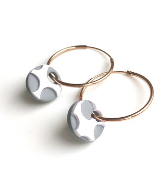 grey spots with white surround on rose gold hoop