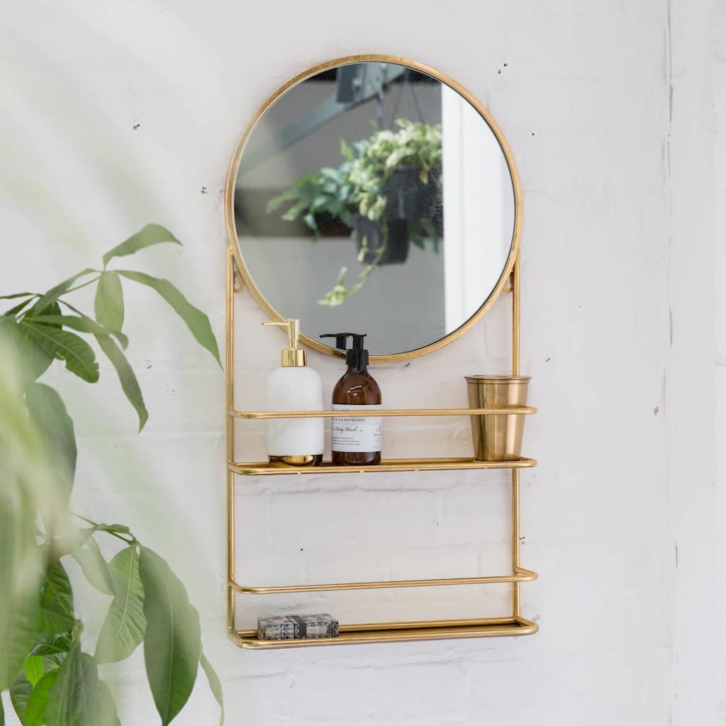 Gold circular wall mirror with shelfs