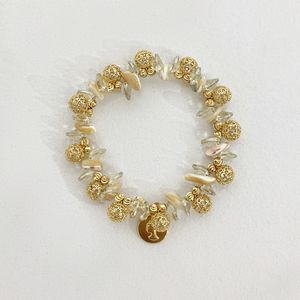 Bcharmd Gold Bead And Shell Bracelet