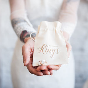 Gold Calligraphy Wedding Ring Bag - shoreline wedding trend