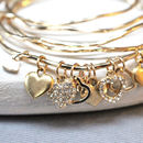 gold diamante heart bangle close up