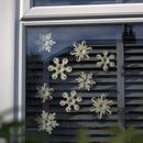 exterior view of wooden snowflake window decorations