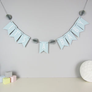 'It's A Baby' Bunting With Honeycomb Pom Poms - children's room accessories