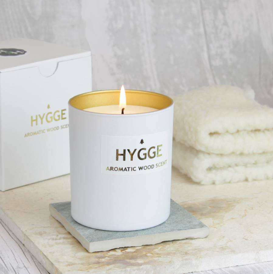 Hygge scented candle with aromatic wood scent by hearth for How to scent candles