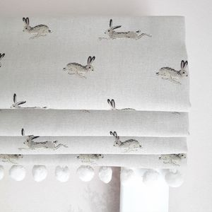 Jumping Hares Blackout Roman Blind - baby's room