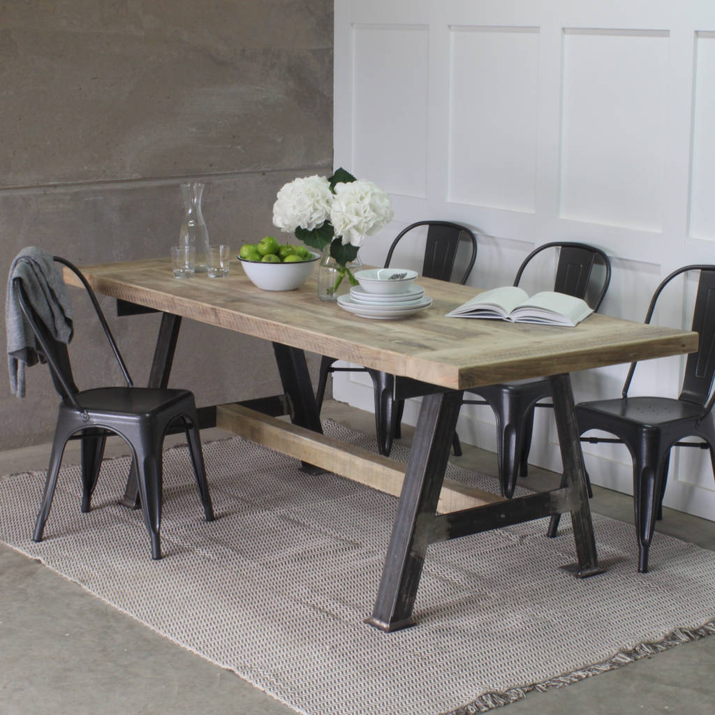A game reclaimed wood dining table with steel a frame by for Steel dining table design
