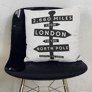 Personalised Distance From North Pole Cushion - living room