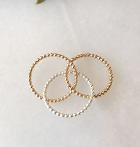 Skinny Beaded Gold And Silver Trinity Ring