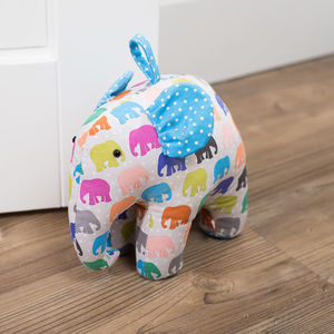 Elephant Parade Spotty Herd Shaped Doorstop - door stops & draught excluders