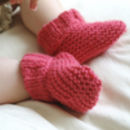 Baby booties beginner knitting kit in coral pink