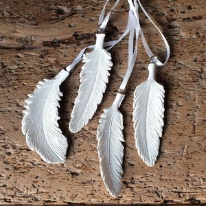 Four Sparkling Feather Decorations