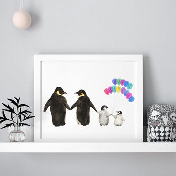personalised penguin family print on a shelf