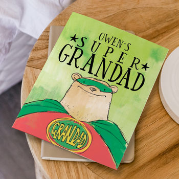 personalised super grandad book for children on table top